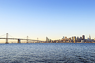 USA, California, San Francisco, Oakland Bay Bridge and skyline of Financial District in morning light - BRF000681