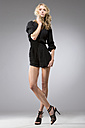 Woman wearing black overall and high heels - MAE009066