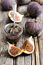 Figs and a glass of fig jam on a wooden table - ODF000825