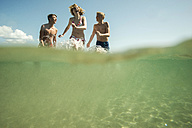 Three teenagers enjoying beachlife - UUF001694