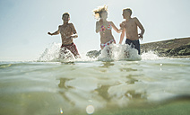 Three teenagers enjoying beachlife - UUF001696