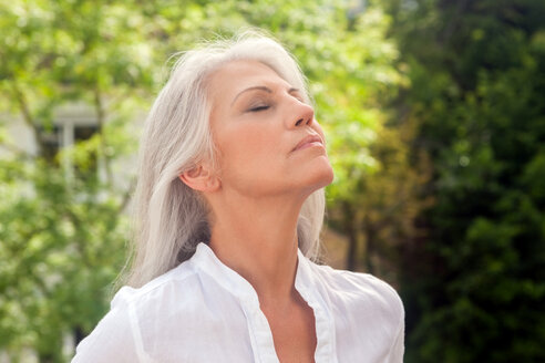Portrait of mature woman enjoying fresh air - CHAF000135