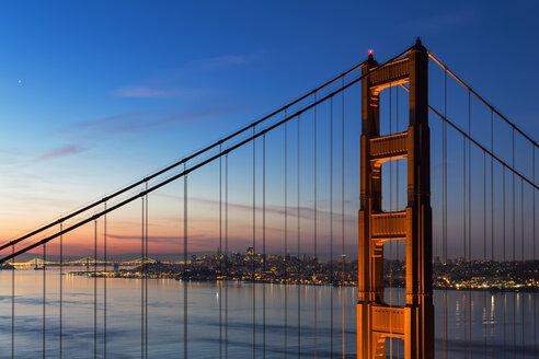 USA, California, San Francisco, skyline and Golden Gate Bridge at the blue hour seen from Hawk Hill - FOF007040
