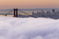 USA, California, San Francisco, skyline and Golden Gate Bridge in fog seen from Hawk Hill - FOF007015