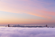 USA, California, San Francisco, skyline and Golden Gate Bridge in fog seen from Hawk Hill - FO007019