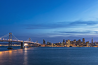 USA, California, San Francisco, Skyline and Oakland Bay Bridge in the evening - FOF007058