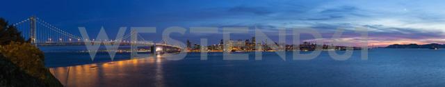 USA, California, San Francisco, Skyline and Oakland Bay Bridge in the evening - FO007061