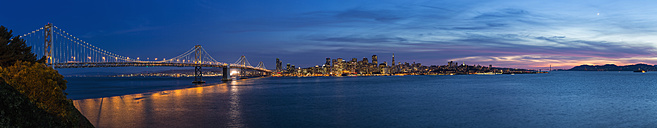 USA, California, San Francisco, Skyline and Oakland Bay Bridge in the evening - FO007061