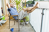 Man relaxing on his balcony - MBEF001125