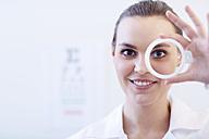 Portrait of smiling optometrist - ZEF000619
