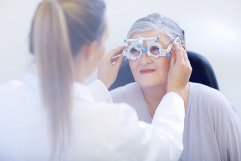 Eye doctor examining senior woman's vision - ZEF000654