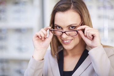 Woman at the optician trying on glasses - ZEF000705