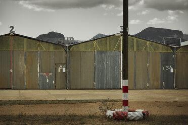 Spain, Majorca, old shacks in deserted landscape - KOF000044