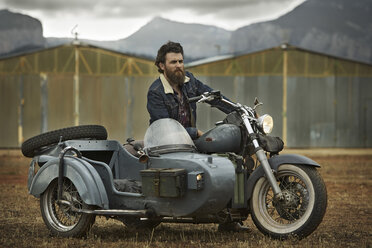 Man with full beard in motorcycle with sidecar - KOF000009