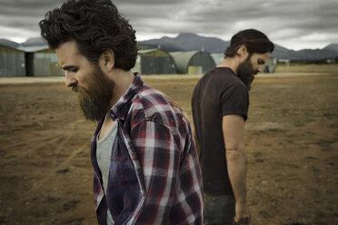 Two men with full beards in abandoned landscape - KOF000020