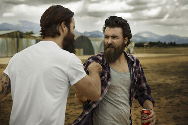 wo men with full beards fighting in abandoned landscape - KOF000035