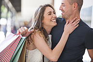 Happy couple on a shopping spree - ZEF000163