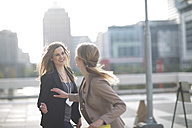 Businesswoman saying good bye to her colleague - ZEF000241