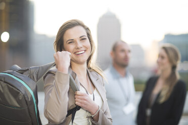Portrait of smiling businesswoman with backpack - ZEF000260