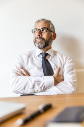 Portrait of pensive businessman at home office - MBEF001155