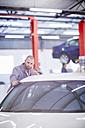 Car mechanic at work in repair garage - ZEF000667