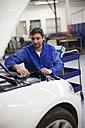 Car mechanic at work in repair garage - ZEF000564