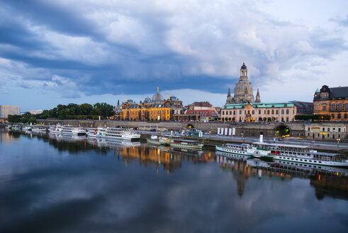 Germany, Saxony, Dresden, cityscape at dusk with paddlesteamers on River Elbe - WGF000447