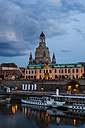 Germany, Saxony, Dresden, cityscape at dusk with paddlesteamers on River Elbe - WGF000449