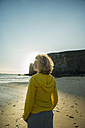 France, Brittany, Camaret-sur-Mer, teenage girl standing on beach - UUF001797