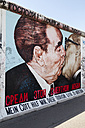 Germany, Berlin, Friedrichshain, mural painting 'brother's kiss' at East Side Gallery - WI001032