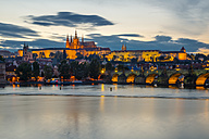 Czech Republic, Prague, Hradcany Castle and St Vitus Cathedral with Vltava River and Charles Bridge at sunset - WG000456