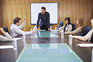 Manager leading business meeting in boardroom - ZEF000269