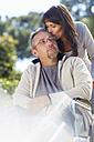 Woman kissing man in wheelchair - ZEF000404
