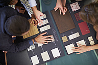 Group of people discussing about color samples - ZEF000275
