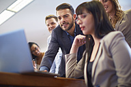 Businesspeople using laptop in boardroom - ZEF000295