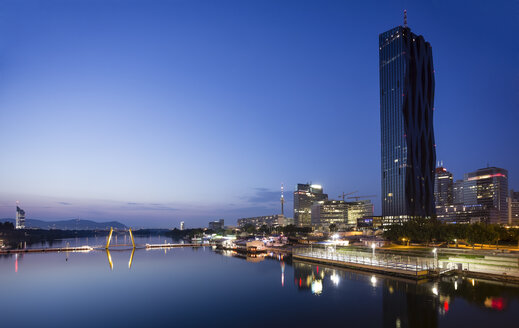 Austria, Vienna, Donau City, Danube River and DC Tower 1 in the evening - DISF001034