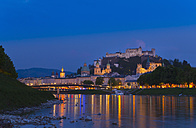 Austria, Salzburg, Salzach river, Hohensalzburg castle at dusk - HSIF000352