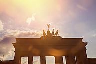 Germany, Berlin, Berlin-Mitte, Brandenburg Gate against the sun - KRPF001148