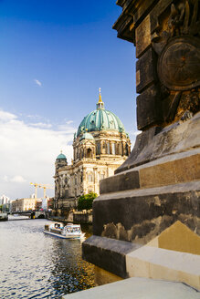 Germany, Berlin, view to Berlin cathedral with tour boat on Spree River in the foreground - KRPF001158