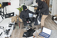 Two burglars at work in an one-family house at daytime - ONF000613