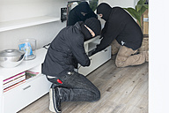 Two burglars at work in an one-family house at daytime - ONF000626