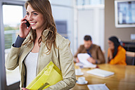 Portrait of businesswoman telephoning with smartphone in the office - ZEF000921