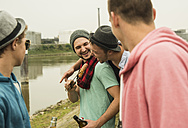 Group of friends drinking beer and having a barbecue - UUF001859