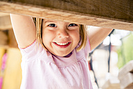 Happy little girl on playground - LVF001882
