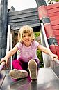 Little girl on playground on slide - LVF001889