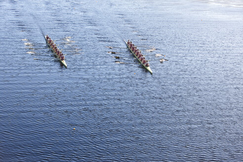 Elevated view of two rowing eights in water - ZEF000458
