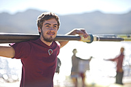 Rower holding oar at lakeshore - ZEF000468