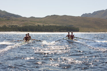 Two double scull rowing boats in water - ZEF000481