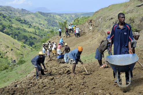 Haiti, Leogane, Bordes,  Villagers building road with support of an aid organization - FLK000433