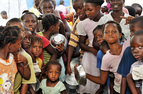 Haiti, Port-au-Prince, Camp for earthquake victims in Croix-de--Bouquet, Children waiting at the food bank - FLK000462